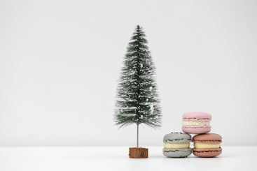 Christmas tree and french macaroons or macarons dessert...