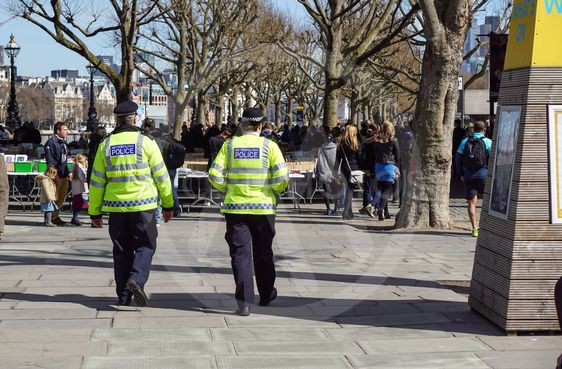 LONDON, UK - APRIL 22, 2017: : London police walking on...