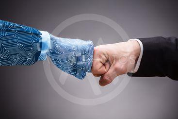 Digital Generated Human Hand And Businessman Making Fist...
