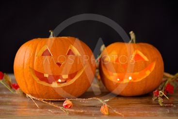 close up of pumpkins on table