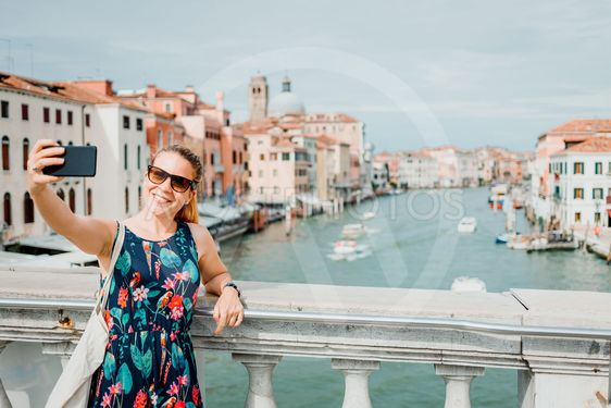 Young woman using smartphone in Venice, Italy