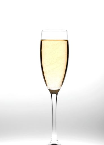 champagne glasses on grey