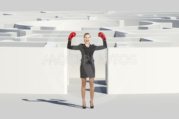 Businesswoman in boxer gloves with suitcase