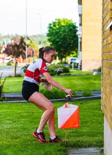 Female at controll point during a sprint orienteering...