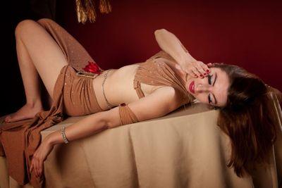 Beautiful Belly Dancer Lying Down