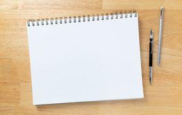 Blank Sketch Paper Tablet Binder Resting on Desk Top...