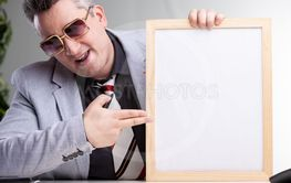 Smart successful man pointing to a blank notice