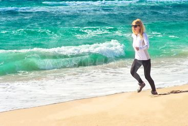 Young Woman Running Training Sport on Beach Seaside sand...
