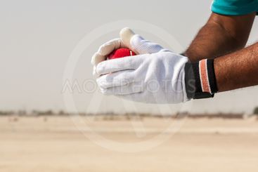 Taking the catch of red ball with hands