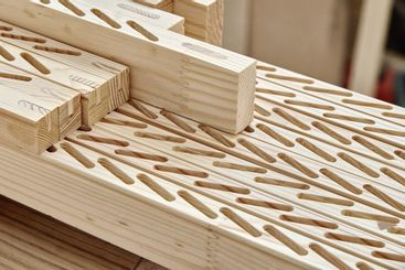 Wooden bars with slots for installing planks on workbench