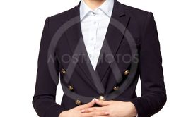 Pretty blonde woman in business outfit stands with folded...