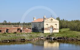 Old abandoned church at the mouth of the river Po - Italy