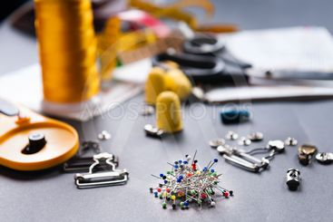 sewing tools on dark background