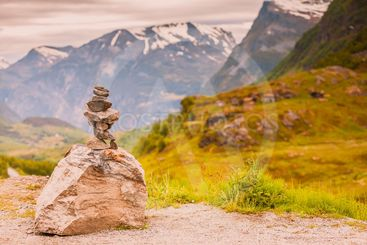 Stone stack and snowy mountain tops, Norway