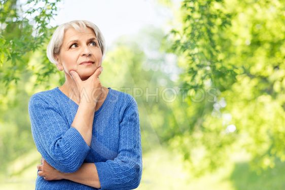 senior woman thinking over natural background