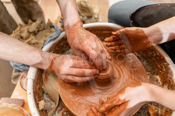 Master ceramist teaches student.Master ceramist teaches...