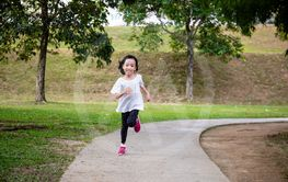 Asian Little Chinese Girl running happily