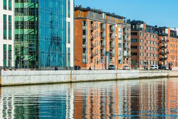 Buildings reflected in water