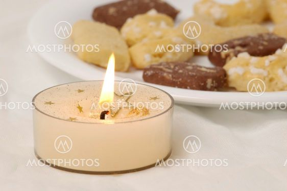 Candle and christmas cookies