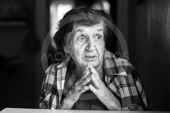 Emotional elderly woman black and white portrait.