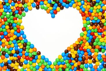 White heart shape with candy background