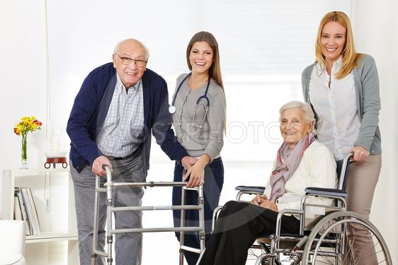 Woman with senior couple getting help from caregiver