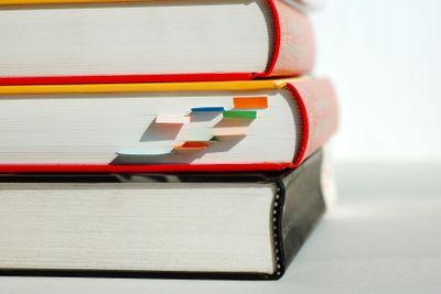 Three piled books