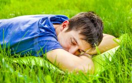 Young Man sleep on the Grass