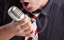 Man engrossed in his music holding a microphone
