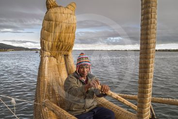 Boatman and Totora reed boat