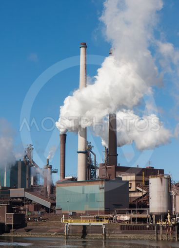 Steel factory with big chimneys in IJmuiden, the...
