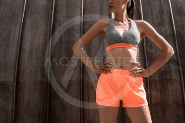 cropped view of athletic woman posing in sportswear