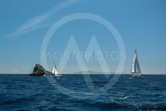 Sailing in the wind through the waves at Sea. Luxury...