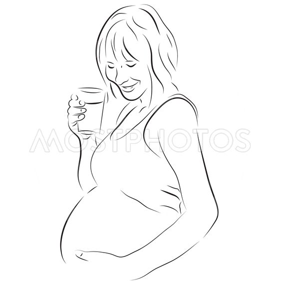 Pregnant woman with a glass of milk