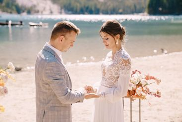 The bride puts a ring on to the groom at venue for the...