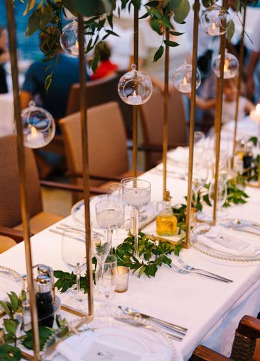 Close-up of a wedding dinner table at reception. Candles...