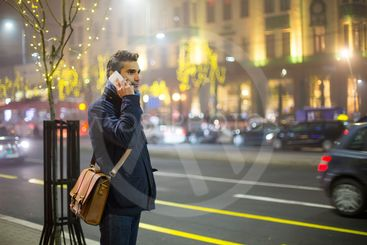 Young man outdoors with mobile phone