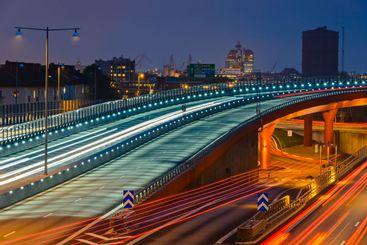 Empty, illuminated city overpass at night