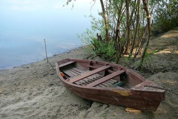 old wooden boat on river coast