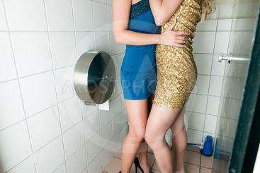 Two women kissing in the toilet