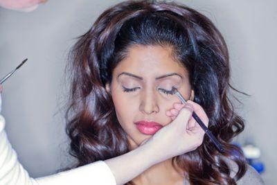 putting make up