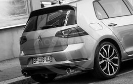 Rear view of grey Volkswagen Golf GTI parked in the street