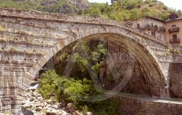The ancient Roman bridge at sunset in the town of Pont...