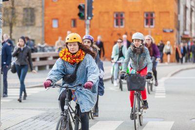 COPENHAGEN, DENMARK - APRIL 28, 2015: People going by...