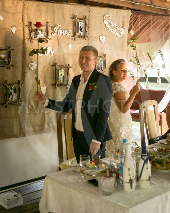 Toned shot of happy smiling bride and groom posing at...