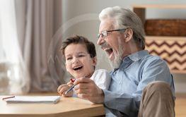 Happy grandparent enjoy drawing in album with grandson