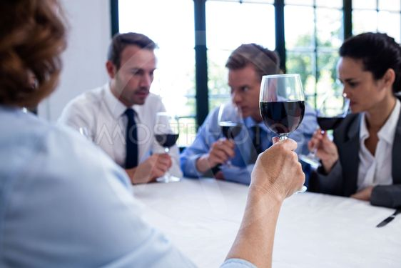 Group of businesspeople drinking wine glass during...