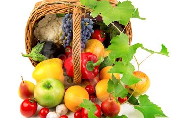 collection of fruits and vegetables in a wicker basket