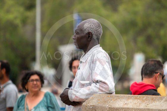 Black elder man watching the river