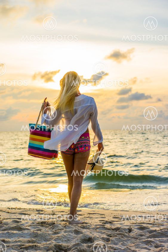 Woman in swiming suit posing on the beach